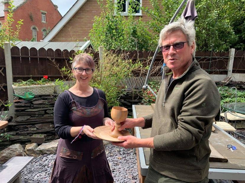 Sara receiving a communion set from a local woodworker